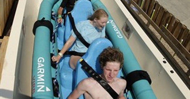 Heart pounds, eyes close on the tallest waterslide