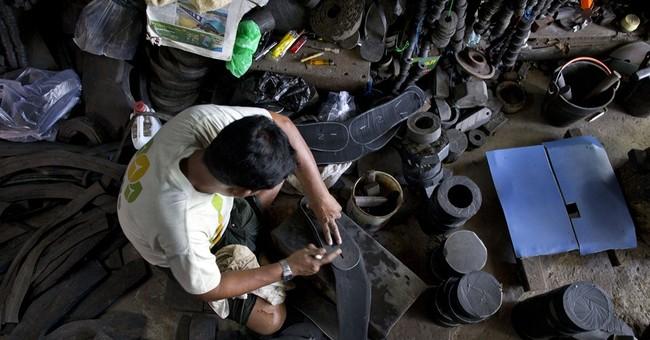 In Myanmar shops, old tires find many new lives