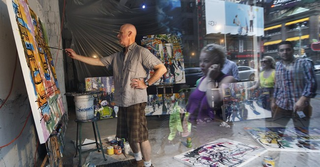 Pedestrians watch artists work in NYC storefront