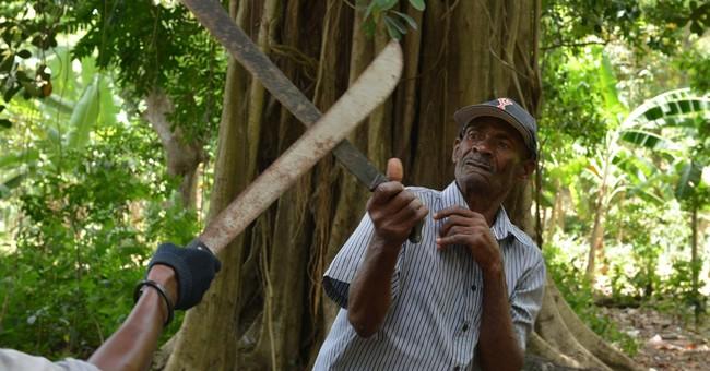 Grace, danger blend in Haiti's machete fighting