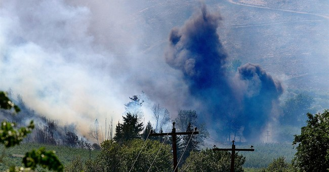 Central Washington wildfire grows dramatically