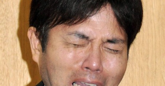 Sobbing Japanese politician tenders resignation