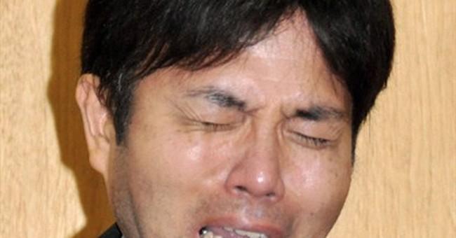 Sobbing Japanese politician tenders resignation