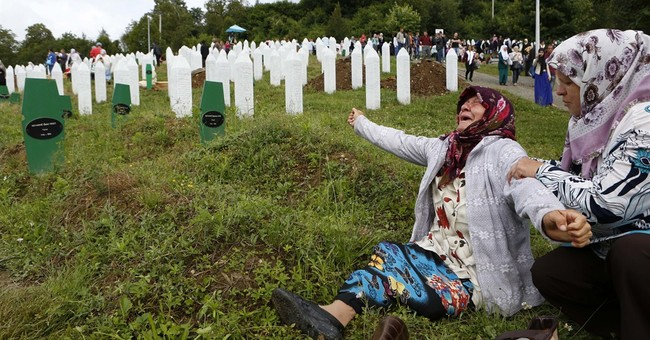 Bosnian mom buries 2 sons 19 years after massacre