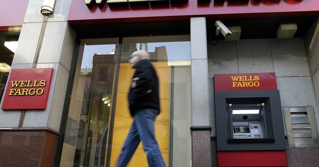 Wells Fargo profit edges up 3 percent in quarter