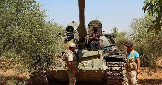 Syrian rebels attack defense minister's village