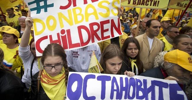 Eastern Ukrainians flee as army suffers losses