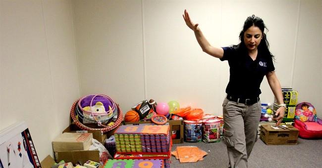 Homeland secretary visits immigrant holding center