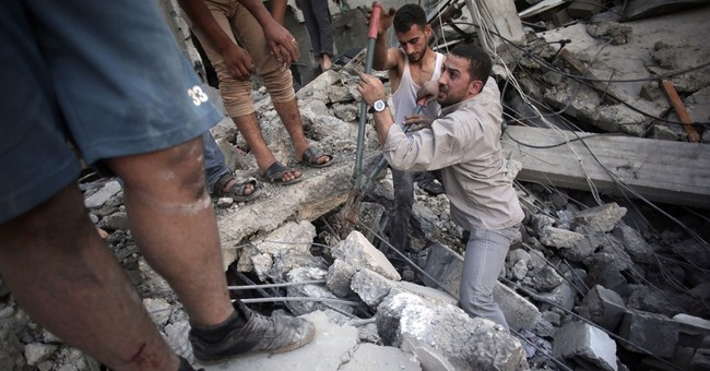 Over 100 killed in Gaza as rockets fall on Israel