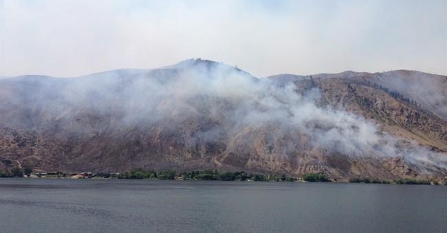 Crews battle wildfires in Washington, California