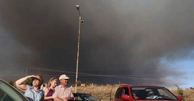 Wildfire threatens town near Athens