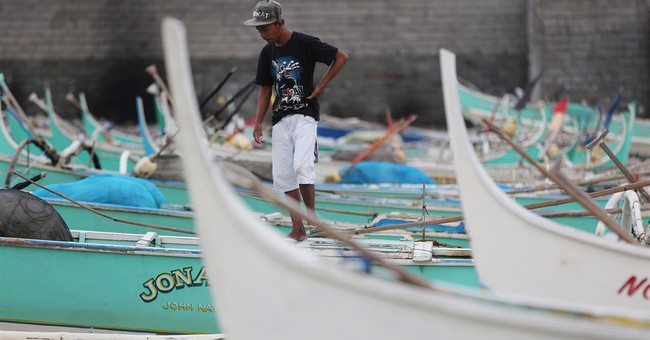 Philippines braces for floods, slides from typhoon
