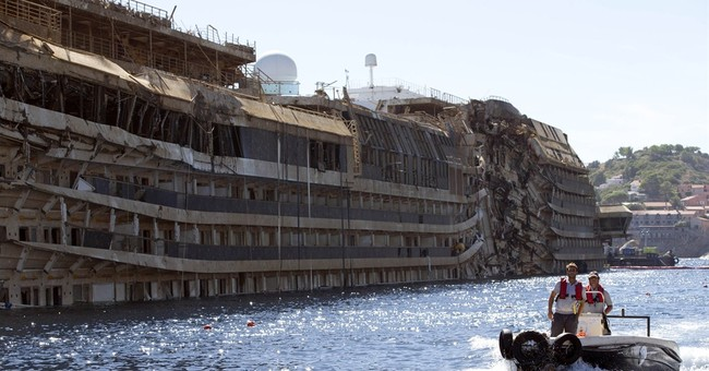 Shipwrecked Concordia floated for tow to Genoa