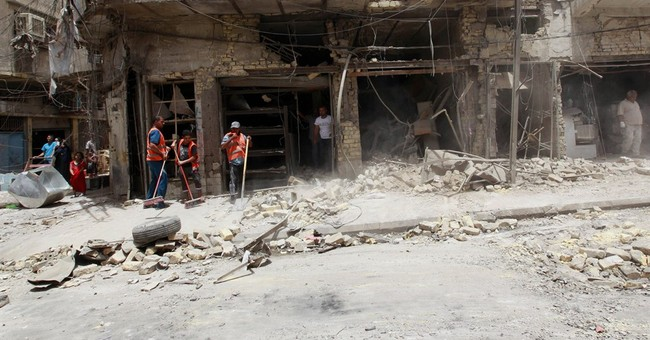 Fighting rages over Iraqi town north of Baghdad