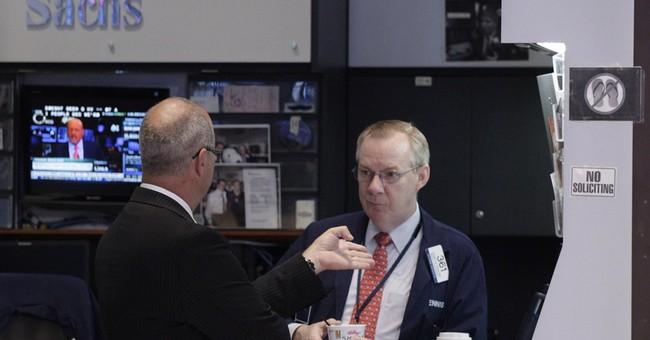 Goldman Sachs posts higher profit and revenue