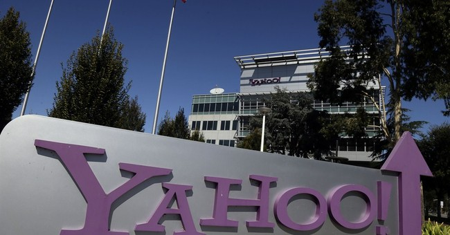 Yahoo 2Q earnings, revenue fall amid ad slump