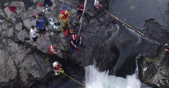 Man rescued from base of raging waterfall