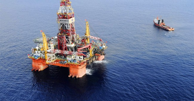 China moves oil rig out of waters Vietnam claims