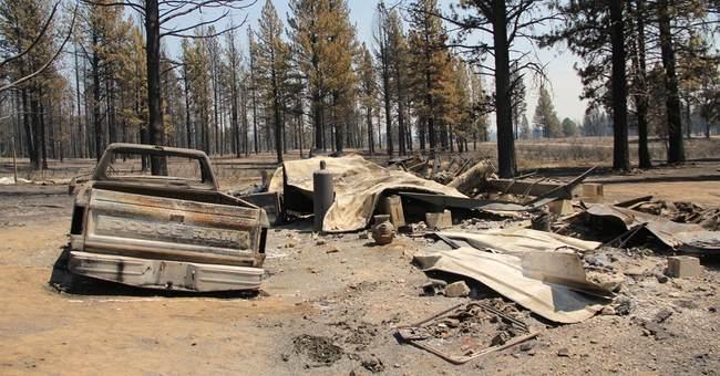 Winds fan Washington wildfire, threaten homes