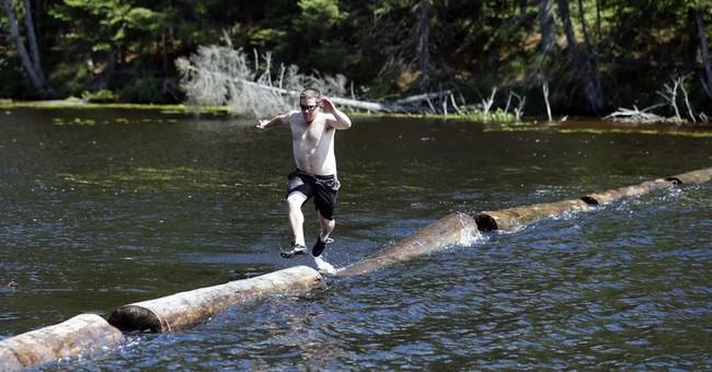 Ax throw, log climb at Adirondack lumberjack class