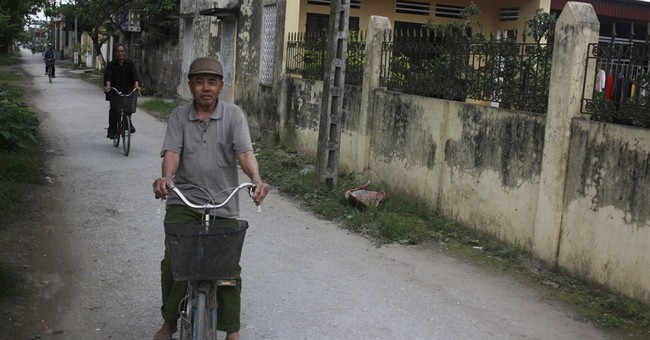 As Vietnam's women go abroad, dads tend the home
