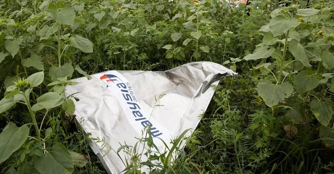 AP PHOTOS: Malaysia plane carrying 298 shot down