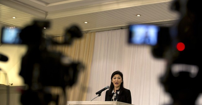 Thailand's ousted PM says she won't flee charges