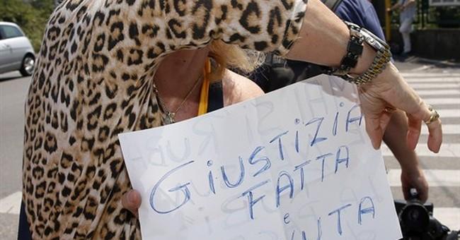 Italian court acquits Berlusconi in sex case