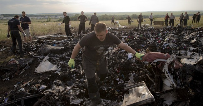 Monitors try to secure Ukraine plane crash site