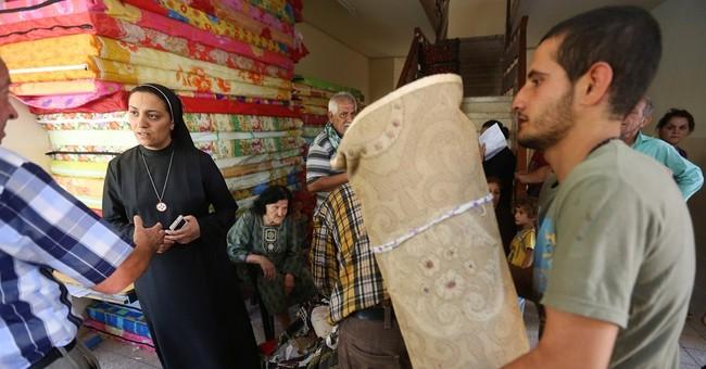 Under threat, Iraq's Christians flee city of Mosul
