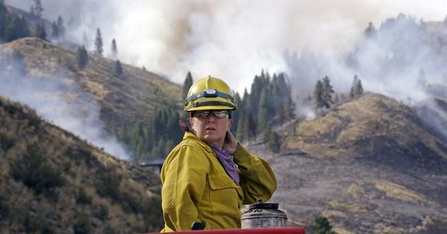 High winds push growing Washington wildfire