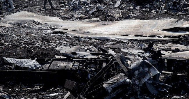 Bodies from downed jet piled in boxcars in Ukraine