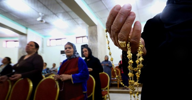 Iraq Christians flee with little more than clothes