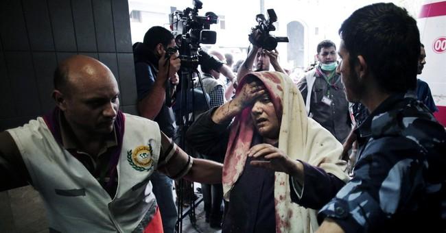 Amid bloodshed, frenetic Gaza hospital improvises