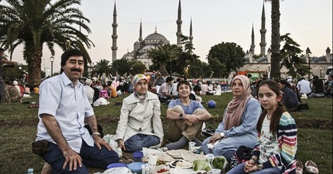 AP PHOTOS: As Ramadan fast ends, the feasts begin