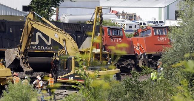 Wisconsin train crash hurts 2 people, spills fuel