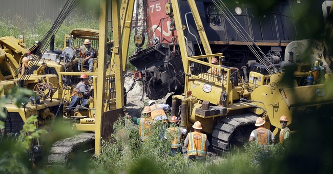Wisconsin train crash hurts 2 people, spills fuel