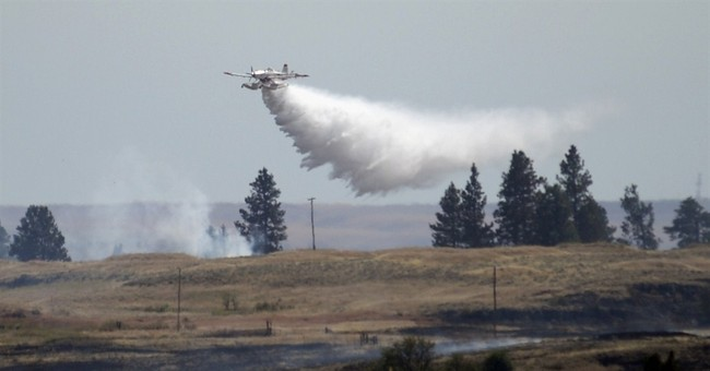 Crews make gains on massive Washington wildfire