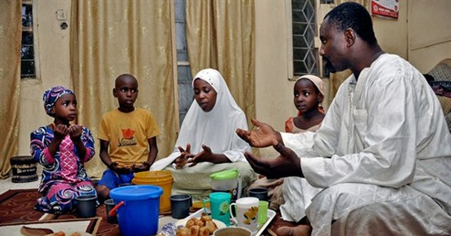 AP PHOTOS: As Ramadan fast ends, the feasts begin