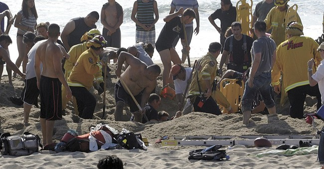 Man dies in California after beach hole collapses