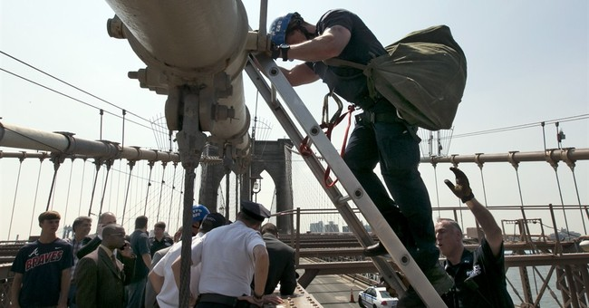 Police probing switch of flags on Brooklyn Bridge