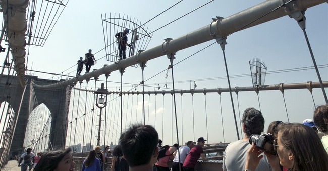 Police probing switch of flags on Brooklyn Bridge