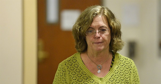 Holmes in court for hearing on expert testimony