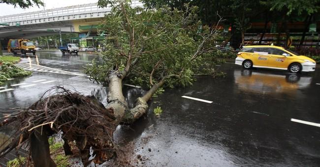 Typhoon rains hit China; plane crashes in Taiwan