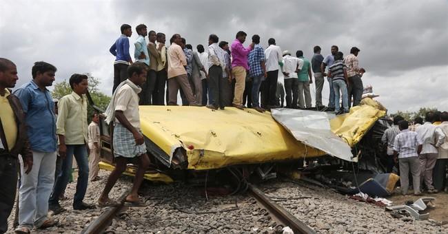 18 children, 1 man die in train-bus crash in India
