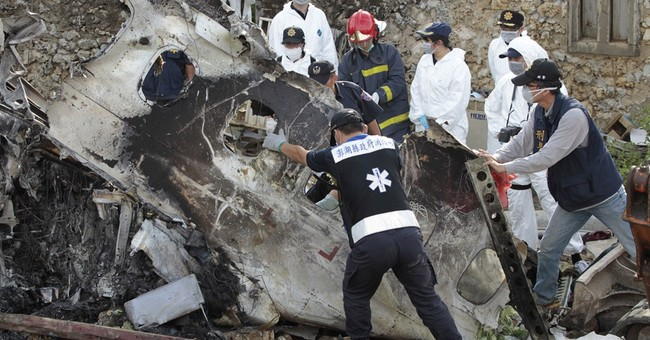 Taiwan searches plane wreckage for clues on crash