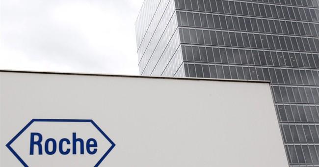 Swiss drug maker Roche posts 7 percent profit drop