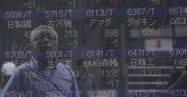 World stocks fall on US earnings, Russia sanctions