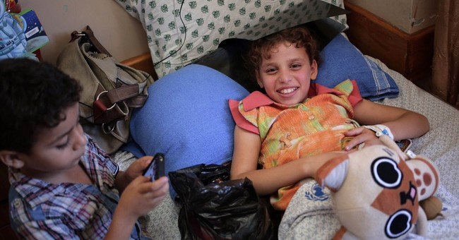 In Gaza, pediatrics wing crowded with war wounded