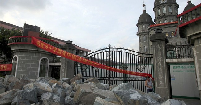 Toppled crosses in China spur defiance